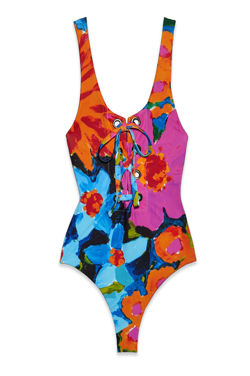 MARA HOFFMAN Desa One Piece - Marigold Floral One Piece | Marigold Floral| Mara Hoffman Desa One Piece - Marigold Floral Flatlay View Scoop Neckline Grommet Lace Up Front Detail  Thick Shoulder Straps Low Scoop Back High Cut Leg Moderate Coverage Made in the USA of Italian fabric 78% recycled polyester, 22% spandex Hand wash cold, dry flat Fabric contains SPF 50 Fabric is digitally printed and engineered to reduce waste