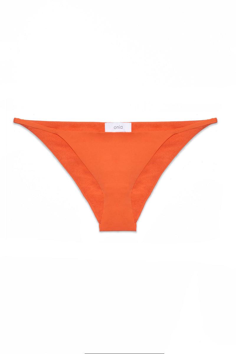 ONIA Rochelle Bikini Bottom - Sunrise Bikini Bottom | Sunrise| Onia Rochelle Bikini Bottom - Sunrise Flatlay View Thin Fixed Side Straps Cheeky Coverage Clean Lined Seams  85% Nylon 15% Spandex