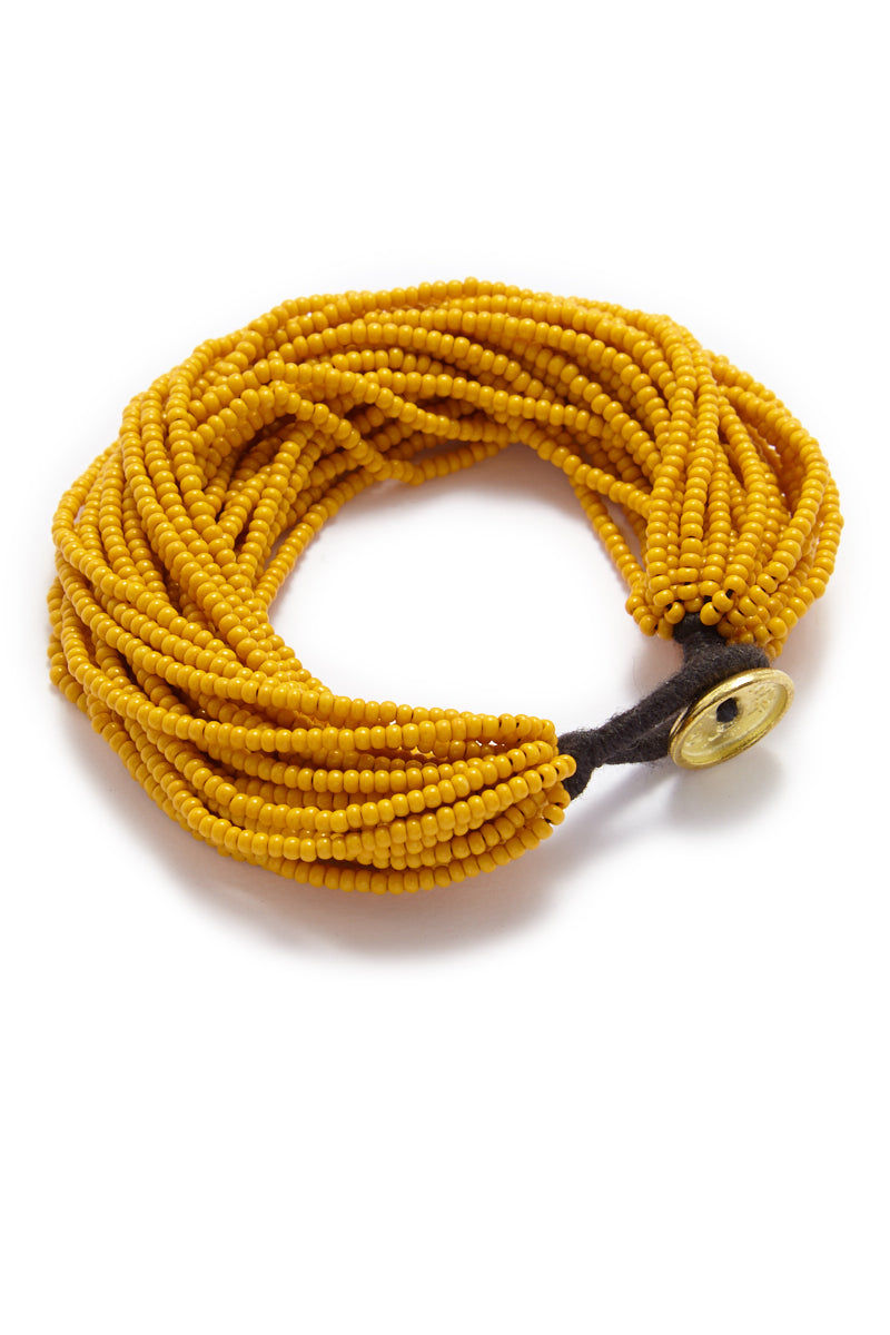 INK + ALLOY Seed Bead Multi-Layer Bracelet - Mustard Yellow Jewelry | Seed Bead Multi-Layer Bracelet - Mustard Yellow Features:  Mustard yellow seed beads bracelet Cluster of multi-strands beads Button closure type Gold color metal button Deep yellow color beads in Mustard