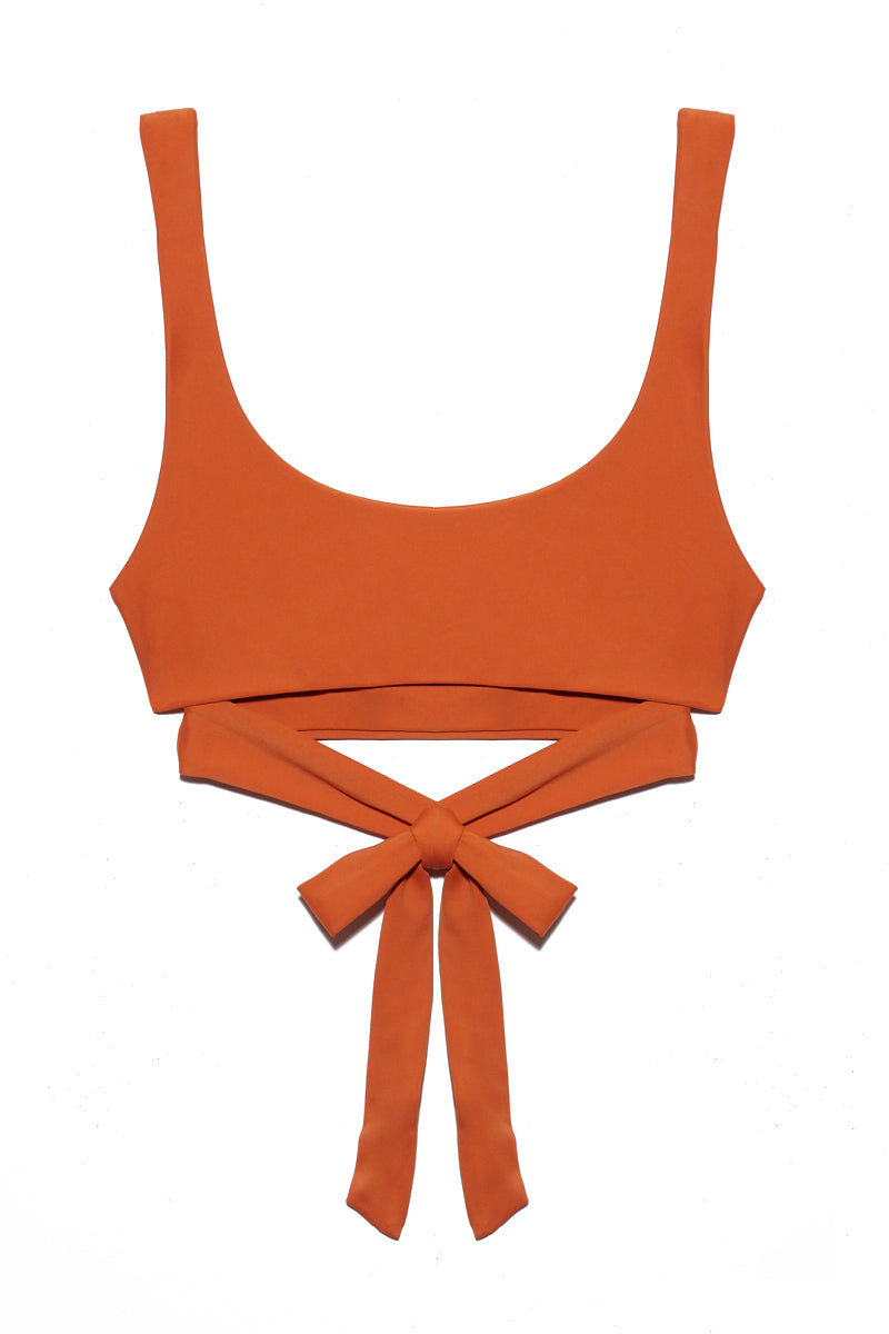 JADE SWIM Bond Wrap Bikini Top - Amber Bikini Top | Amber| Jade Swim Bond Scoop Neck Bikini Top - Amber Scoop Neck Wrap Top  Thick Straps  Thin Back Band  82% Nylon, 18% Spandex Made in Los Angeles Care  Hand wash, lay flat to dry Chlorine, oil and cream resistant. Flatlay View