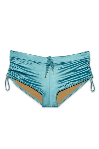 MARLIES DEKKERS Holi Glamour Drawstring Shorts Bikini Bottom - Aqua Blue Bikini Bottom | Aqua Blue|Marlies Dekkers Holi Glamour Drawstring Bikini Bottom (Curves) - Aqua Blue. Flat Lay View. Metallic aqua blue drawstring bikini bottom. Full Coverage. Mid Rise. Shorts bikini bottom. Braided string tie. Scrunch side detail.