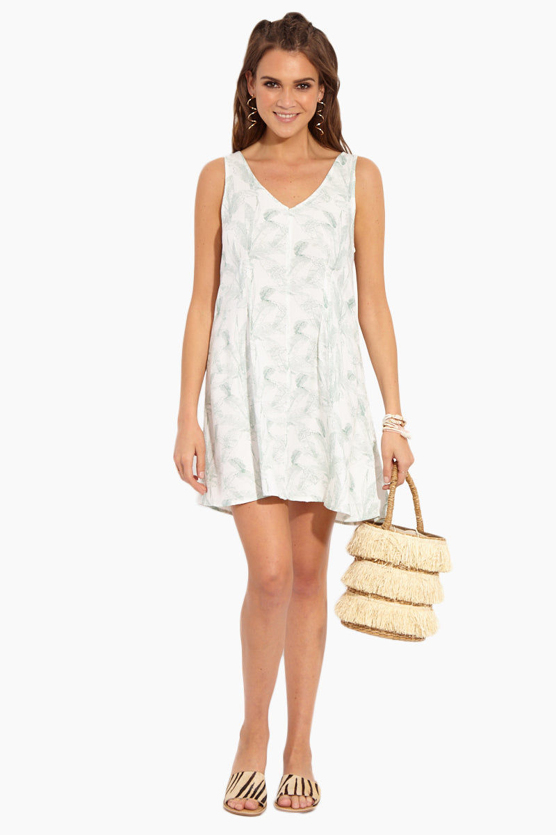RVCA Landline Woven Dress - Vintage White Dress | Vintage White| RVCA Landline Woven Dress - Vintage White Front View Ivory White Woven Twill A-Line Dress in Allover Seafoam Green Palm Print V-Cut Neckline Mid-Thigh Length V-Cut Back With Single Strap