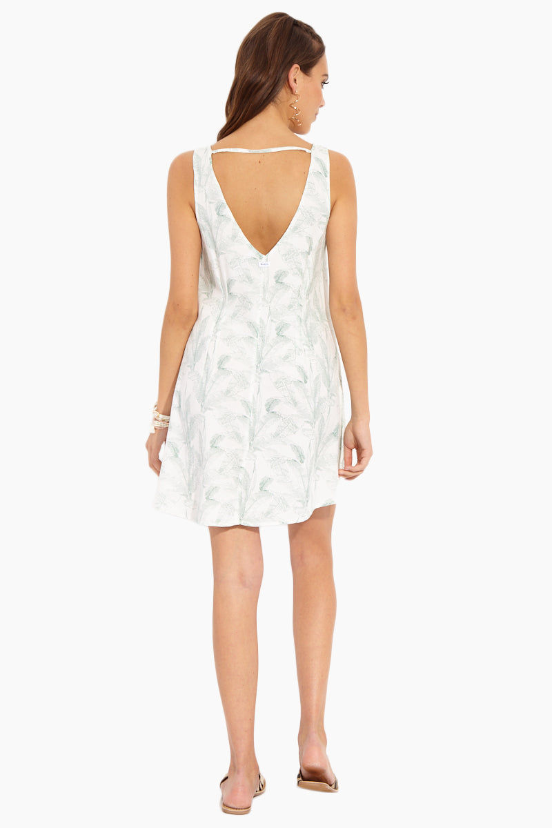 RVCA Landline Woven Dress - Vintage White Dress | Vintage White| RVCA Landline Woven Dress - Vintage White Back View Ivory White Woven Twill A-Line Dress in Allover Seafoam Green Palm Print V-Cut Neckline Mid-Thigh Length V-Cut Back With Single Strap