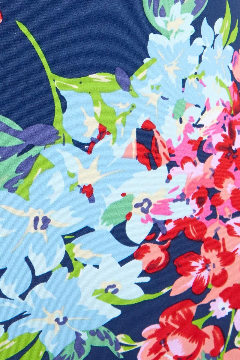 BEACH JOY Halter One Piece - Floral Dreams Print One Piece | Floral Dreams Print| Halter One Piece - Floral Dreams Print. Flat Lay View.Floral deep plunge one piece Halter string tie style plunging neckline with choker detail High cut leg Cheeky minimal coverage