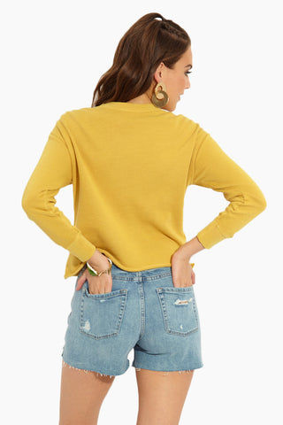 RVCA Slice RVCA Sweatshirt - Harvest Gold Top | Harvest Gold| RVCA Slice RVCA Sweatshirt - Harvest Gold Back View French Terry Washed Pullover Crew Neck Sweatshirt Mustard Yellow RVCA Graphic Logos at Front Acid Wash Dropped Shoulders Raw-Edge Hemline