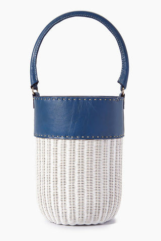 "KAYU Lucie Bucket Tote - Navy/White Bag | | Kayu Luci Bucket Tote - Navy/White Front View Bucket tote Made of woven wicker Navy leather panel around top and handle Drawstring lining  Handcrafted  Measurements: 9.5"" H x 6.5"" diameter"