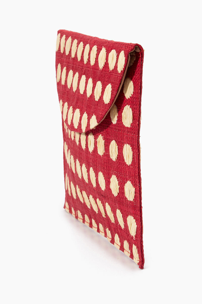 "KAYU Tulum Polka Dot Clutch - Red/White Polka Dots Bag | | Kayu Tulum Polka Dot Clutch - Red / White Polka Dots Side View Natural straw clutch  Hand embroidered polka dot detail  Drop in chain straps  Easily fits largest size cellphone Handcrafted Measurements: 11""w x 7""h"