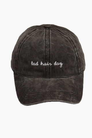 "DAVID & YOUNG Bad Hair Day Slogan Baseball Cap - Black Hat | | David & Young Bad Hair Day Slogan Baseball Cap - Black front view Washed-out black baseball cap with ""bad hair day"" embroidery in white."