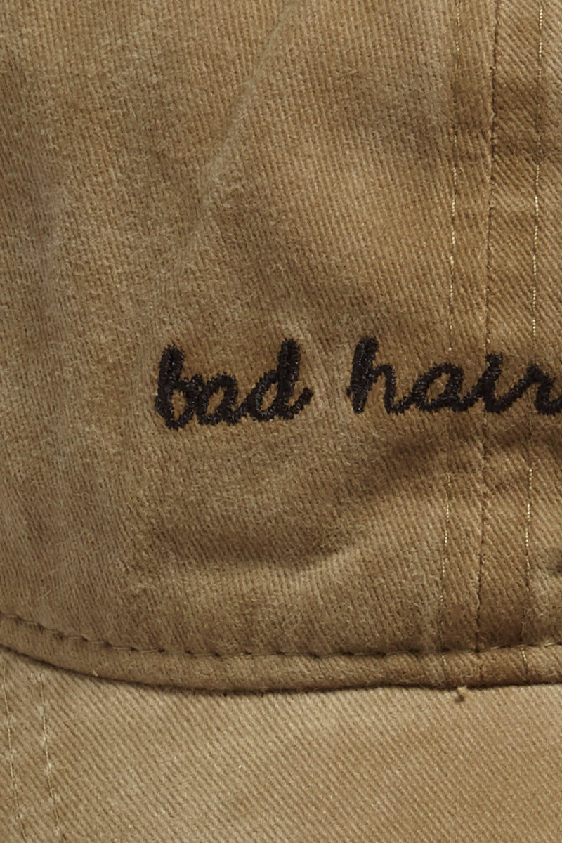 "DAVID & YOUNG Bad Hair Day Slogan Baseball Cap - Khaki Hat | | David & Young Bad Hair Day Slogan Baseball Cap - Khaki detail view Washed-out khaki baseball cap with ""bad hair day"" embroidery in white."