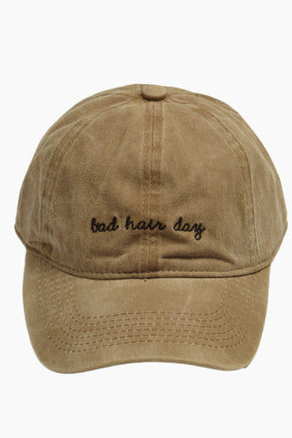 "DAVID & YOUNG Bad Hair Day Slogan Baseball Cap - Khaki Hat | | David & Young Bad Hair Day Slogan Baseball Cap - Khaki front view Washed-out khaki baseball cap with ""bad hair day"" embroidery in white."