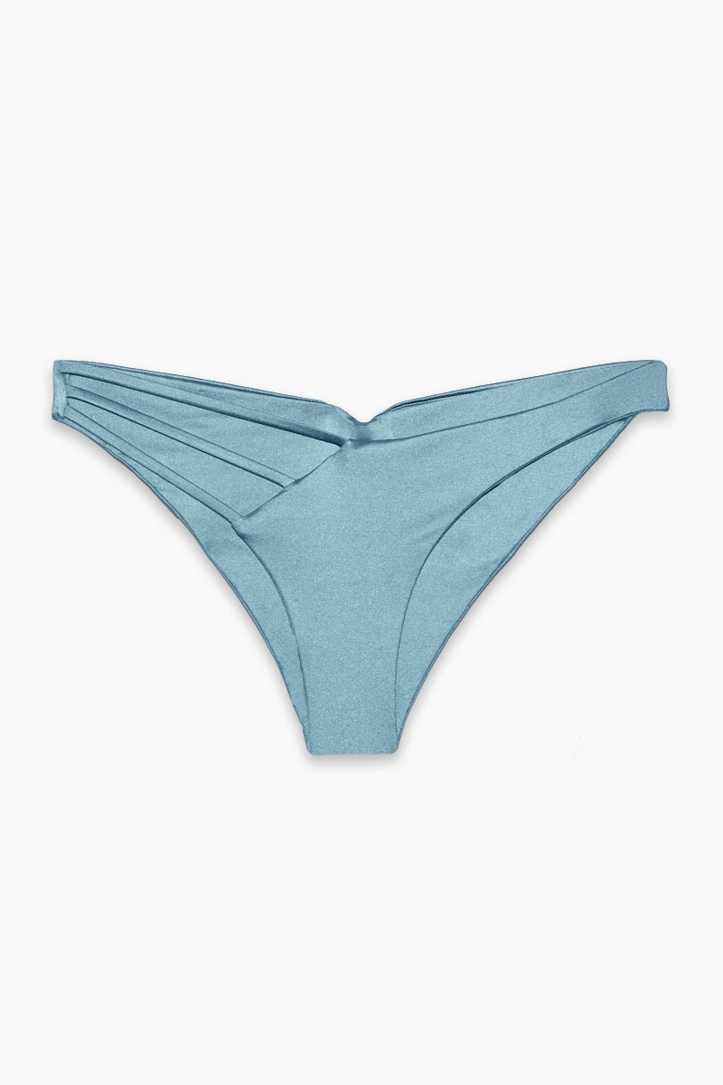 BEACH BUNNY Kennedy Asymmetric Strappy Ruched Bikini Bottom - Dusty Blue Bikini Bottom | Dusty Blue | Kennedy Asymmetric Strappy Ruched Bikini Bottom - Dusty Blue Low-rise asymmetrical bikini bottom in cool dusty blue color. Revealing front cut-out with triple strap detail gives the minimal coverage bottom a super sexy finish. Fully ruched cheeky Front View