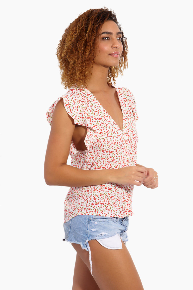 FLYNN SKYE Betsy Blouse - Sweet Cherry Pie Top | Sweet Cherry Pie| Flynn Skye Betsy Blouse - Sweet Cherry Pie Side View Blouse V Neckline  Cut-Off Sleeves  Ruffled Detail   Made in LA  Cherry Print Detail