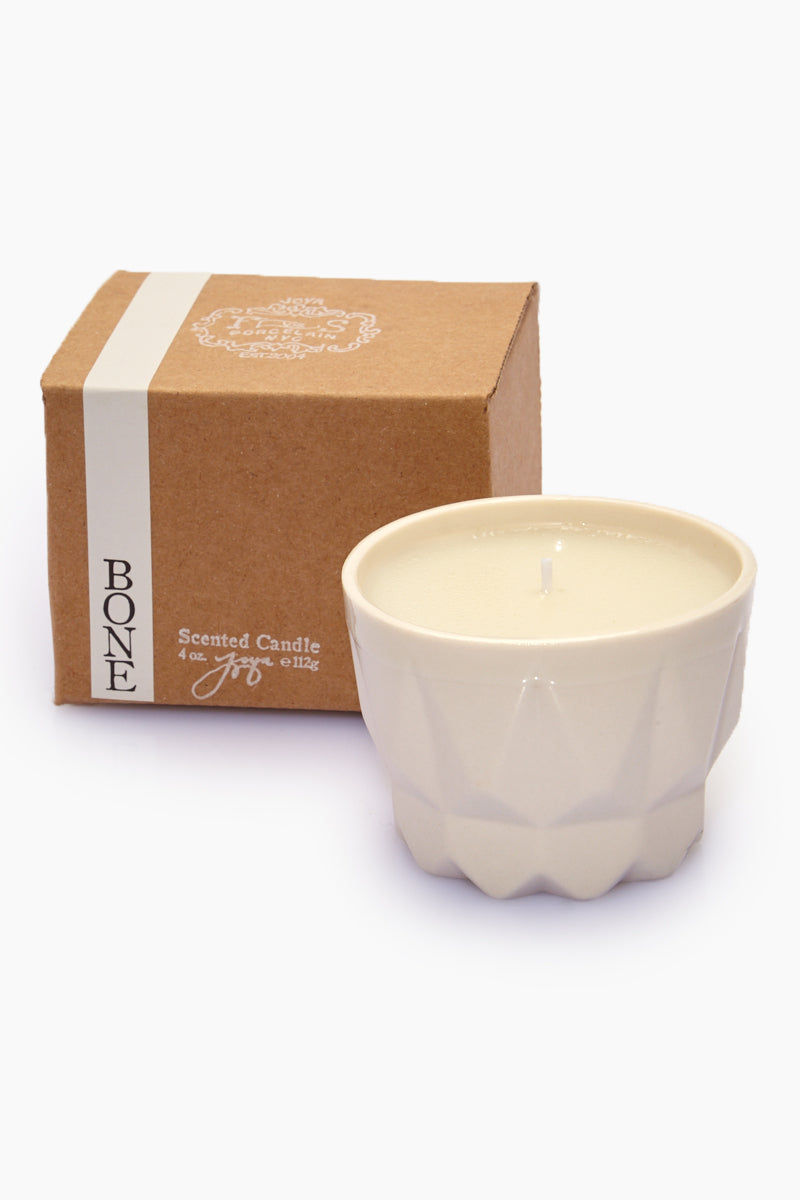 JOYA STUDIO Porcelain Candle - Bone Home | | Joya Studio Porcelain Candle - Bone  With the Box View Hand-poured white wax candle In slip-cast white porcelain container Cherry redwood Net Weight: 112 g / 4 oz. Approximate Burn Time: 35 hours Ingredients: natural soy and beeswax blend, vegetable oil, essential oil, fine fragrance, cotton wick