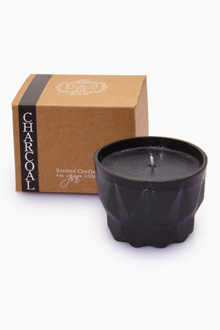 JOYA STUDIO Porcelain Candle - Charcoal Home | | Joya Studio Porcelain Candle - Charcoal With  Box View  Hand-poured black wax candle In slip-cast black porcelain container Santal cedar chip Net Weight: 112 g / 4 oz. Approximate Burn Time: 35 hours Ingredients: natural soy and beeswax blend, vegetable oil, essential oil, fine fragrance, cotton wick