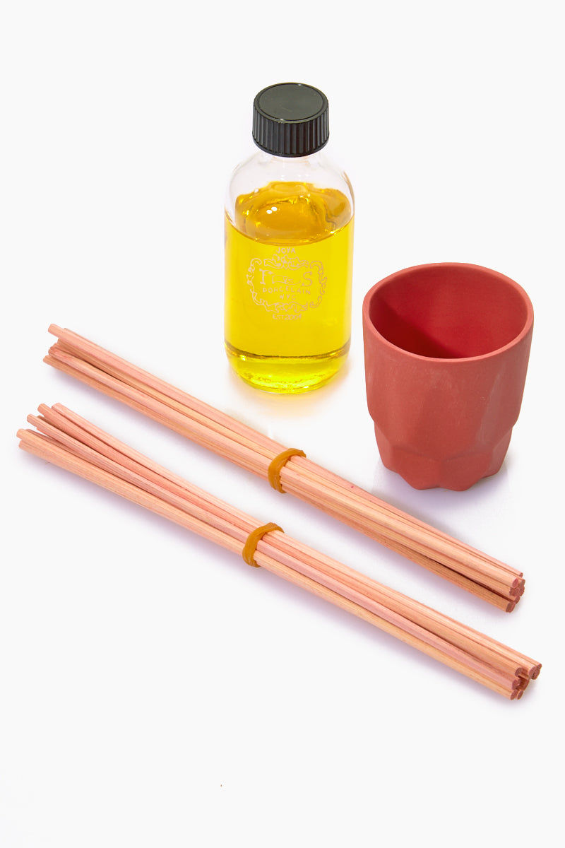 JOYA STUDIO Porcelain Diffuser - Red Home     Joya Studio Porcelain Diffuser - Red Out of the Box View Travel diffuser In hand slip-cast red porcelain container  Comes with 2 sets of sticks Ginger rooibos leaf  Net Weight: 59 ml / 2 oz.