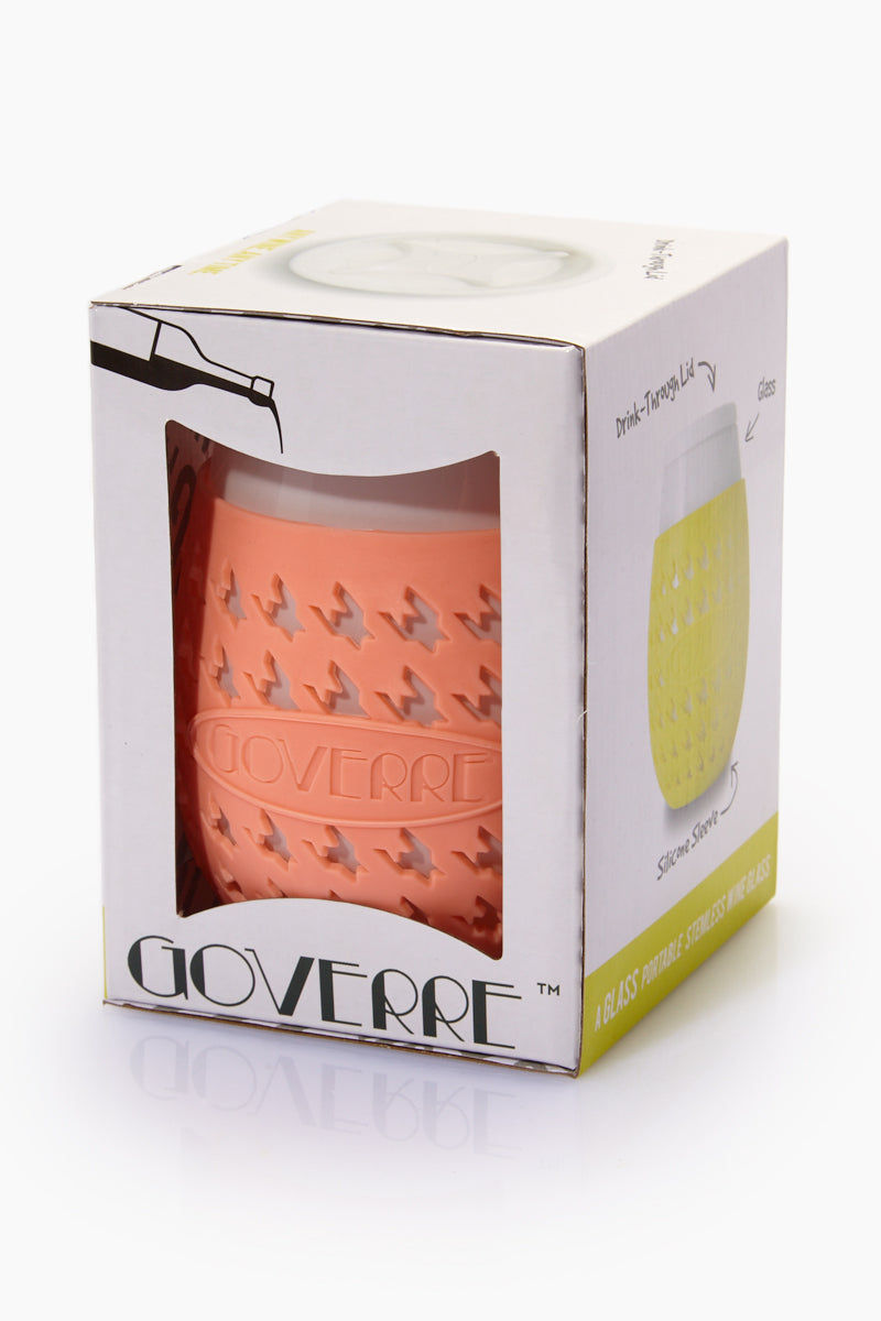 "GOVERRE Wine Glass Sippy Cup - Peach Accessories | Peach| Goverre Wine Glass - Peach Out of Box Lid On View Portable, stemless wine glass with a silicone sleeve and a drink-through lid. Holds 17oz of your favorite beverage  Durable—thicker(.25"") than a typical wine glass  Preserves taste and integrity of your wine Silicone sleeve - Houndstooth-patterned silicone sleeve prevents heat transfer and provides a no-slip grip Phthalate and lead free Dishwasher safe"