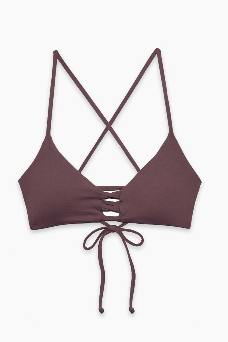 L SPACE Flynn Bralette Bikini Top - Pebble Bikini Top   Pebble  L Space Flynn Bralette Bikini Top - Pebble Bralette 3-strap center detail Laced X-back with adjustable ties Removable pads Fabric Content: 80% nylon, 20% spandex Like all delicates, shape, color and fit are best preserved if hand washed in cold water. Lay flat to dry Flatlay View