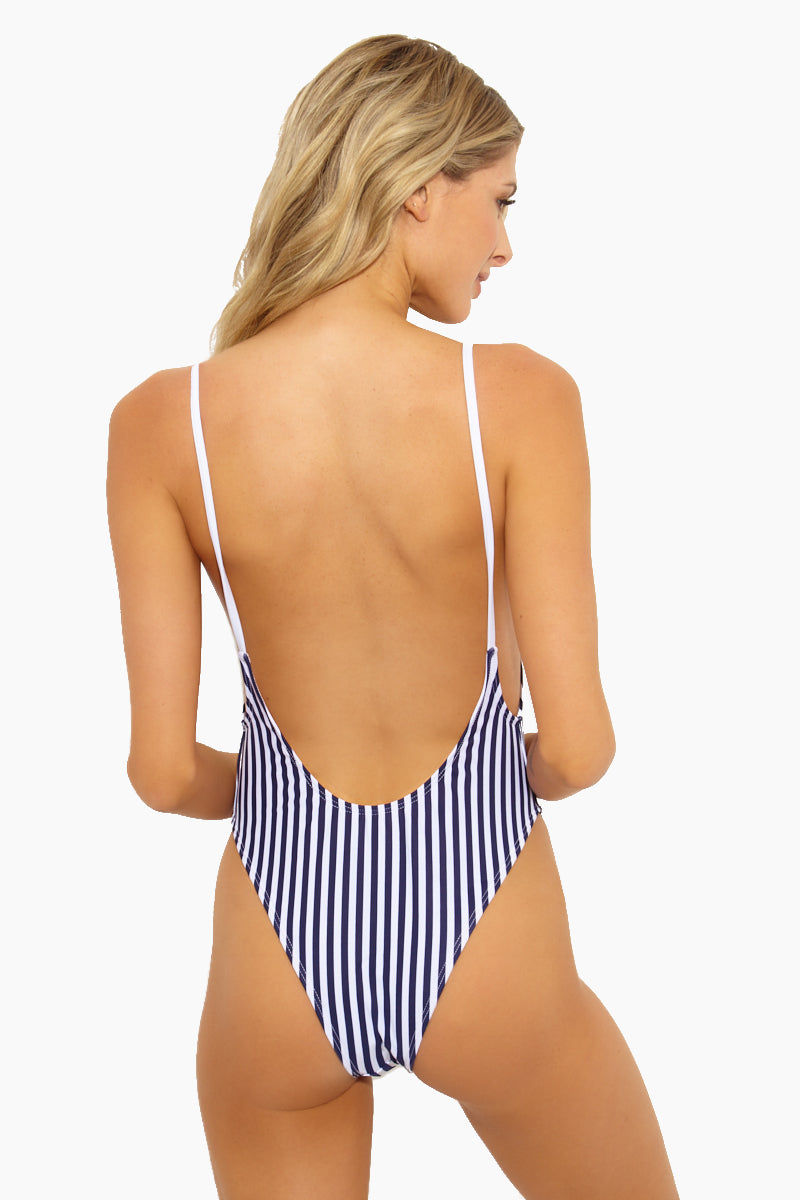 PRIVATE PARTY Mi Amor One Piece Swimsuit- Blue One Piece | Blue|Mi Amor One Piece Swimsuit Features - Deep scoop back Open sides Thin spaghetti straps Form hugging sillhouette No closures fully lined