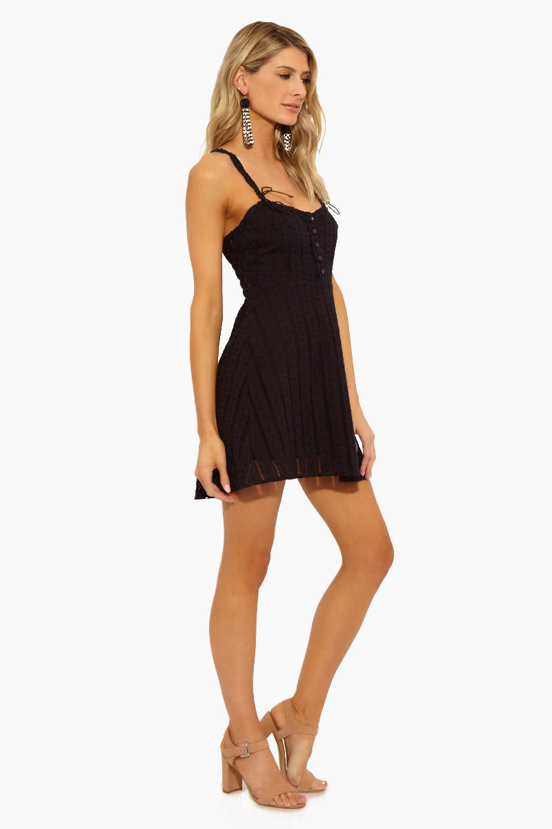 FOR LOVE AND LEMONS Spring Eyelet Mini Dress - Black Dress | Black|Spring Eyelet Mini Dress - Features:  Center Front Button Detailing Fixed Bows on Front and Back Straps Invisible Back Zipper Fit and Flare Sleeveless