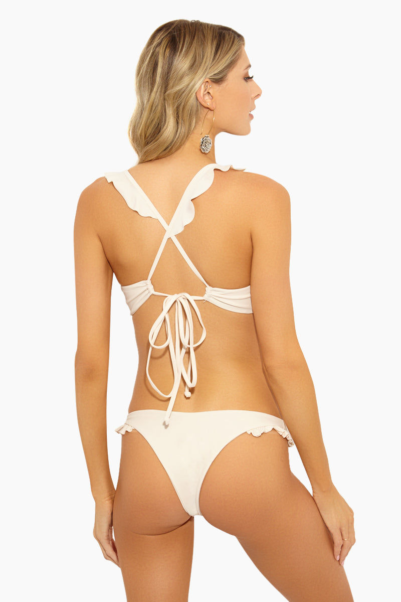 GILLIA Sonia Ruffle Bikini Bottom - Cream Bikini Bottom | Cream| GILLIA Sonia Ruffle Bikini Bottom - Cream STYLE:  Low-rise V-cut skimpy bikini bottom in a luxurious cream shade. Allover minimal coverage is ideal for tanning as it leaves less noticeable tan lines. Ultra romantic ruffle detail on the side straps balance out the sexier aspects of the suit. Brazilian rear cut shows off your curves while providing skimpy coverage.    CARE:  Hand wash in cold water with gentle detergent and lay flat to air dry. 80% nylon, 20% spandex. Back View