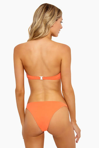 ONIA Genevieve Bikini Top - Sunrise Bikini Top | Sunrise| Onia Genevieve Bikini Top - Sunrise Flatlay View  Bandeau Bikini Top Nickel Hardware U-Shaped Boning Lightly Padded Cups Hidden Underwire Hook Back Closure  Ruched Front  Nickel Hardware  Fully Lined