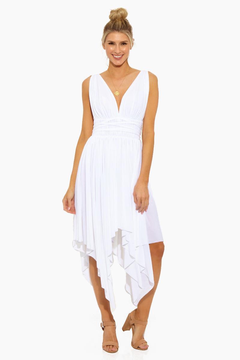 NORMA KAMALI Goddess Dress - White Dress | White | Norma Kamali Goddess Dress - White Front View  Deep V Neckline Lightly Draped Bust  String Tie at Waist  Draped Asymmetric Skirt  Handkerchief Hem  Unlined Polyester