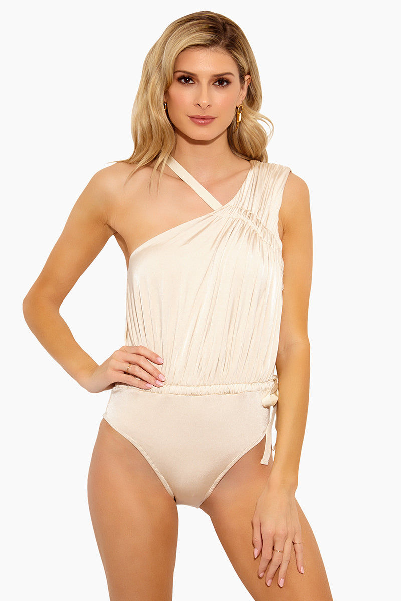 DEREK LAM 10 CROSBY Asymmetric Ruched Tie One Piece Swimsuit - Champagne One Piece | Champagne|Asymmetric Ruched Tie One Piece Swimsuit - Features: One-shoulder design. Wide strap over one shoulder with ties at the opposite shoulder. Rouching at the bodice. Self ties at the waist. Cheeky rear coverage.