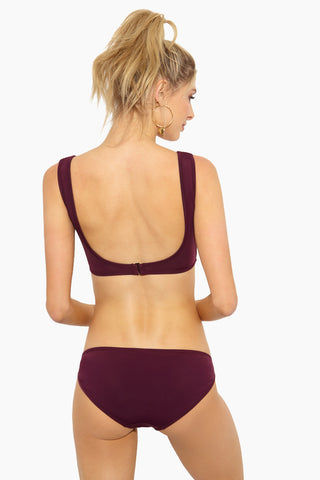 BETH RICHARDS Ines Tank Bikini Top - Port Bikini Top | Port| Beth Richards Ines Tank Bikini Top - Port. Flat Lay View.  FEATURES:  Tank style top with V-wire front G-hook back closure Fabric: 80% Polyamide, 20% Elastane Lined High-Quality Italian Stretch fabric Resistant to oils, lotions, sweat, and chlorine UPF 50+ Protection against UV Rays Ethically Made in Canada Fits mostly true to size