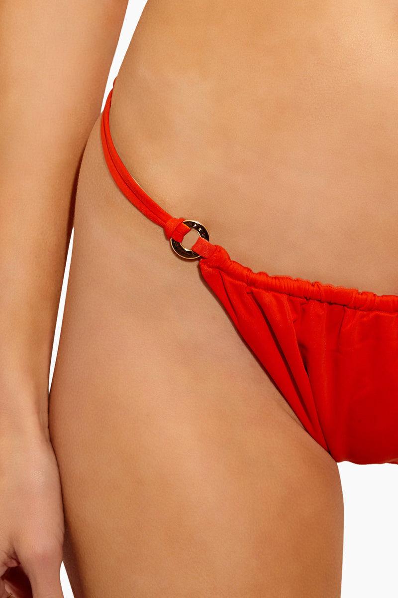 FELLA Xavier Bottom - Burnt Orange Bikini Bottom | Burnt Orange | Fella Xavier Bottom - Burnt Orange Features:  Double string cheeky bottom Disc rings at front Front ruching Italian Lycra
