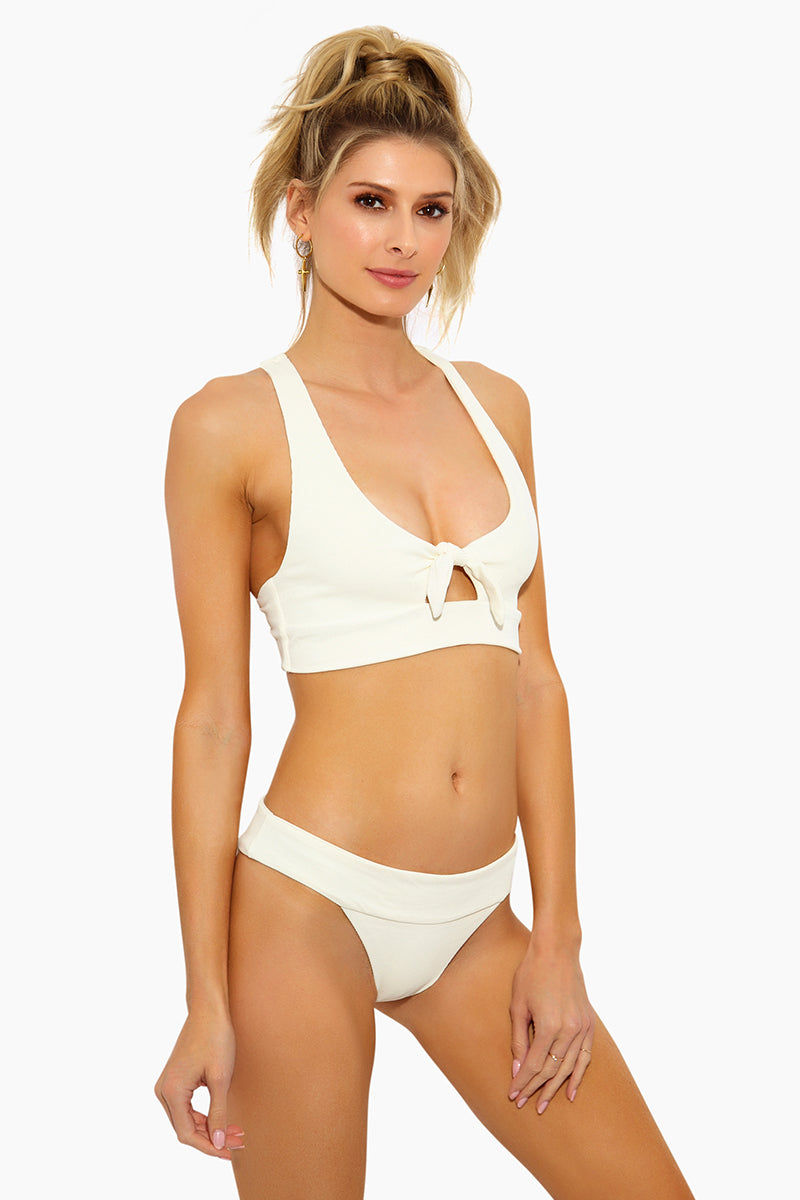 L SPACE Veronica Thick Band Bikini Bottom - Cream Bikini Bottom | Cream|  L Space Veronica Thick Band Bikini Bottom - Cream  Thick band across waist that creates a fold-over look Seamless construction Classic/moderate coverage 80% nylon, 20% spandex Made in the USA Like all delicates, shape, color and fit are best preserved if hand washed in cold water. Lay flat to dry. Side View