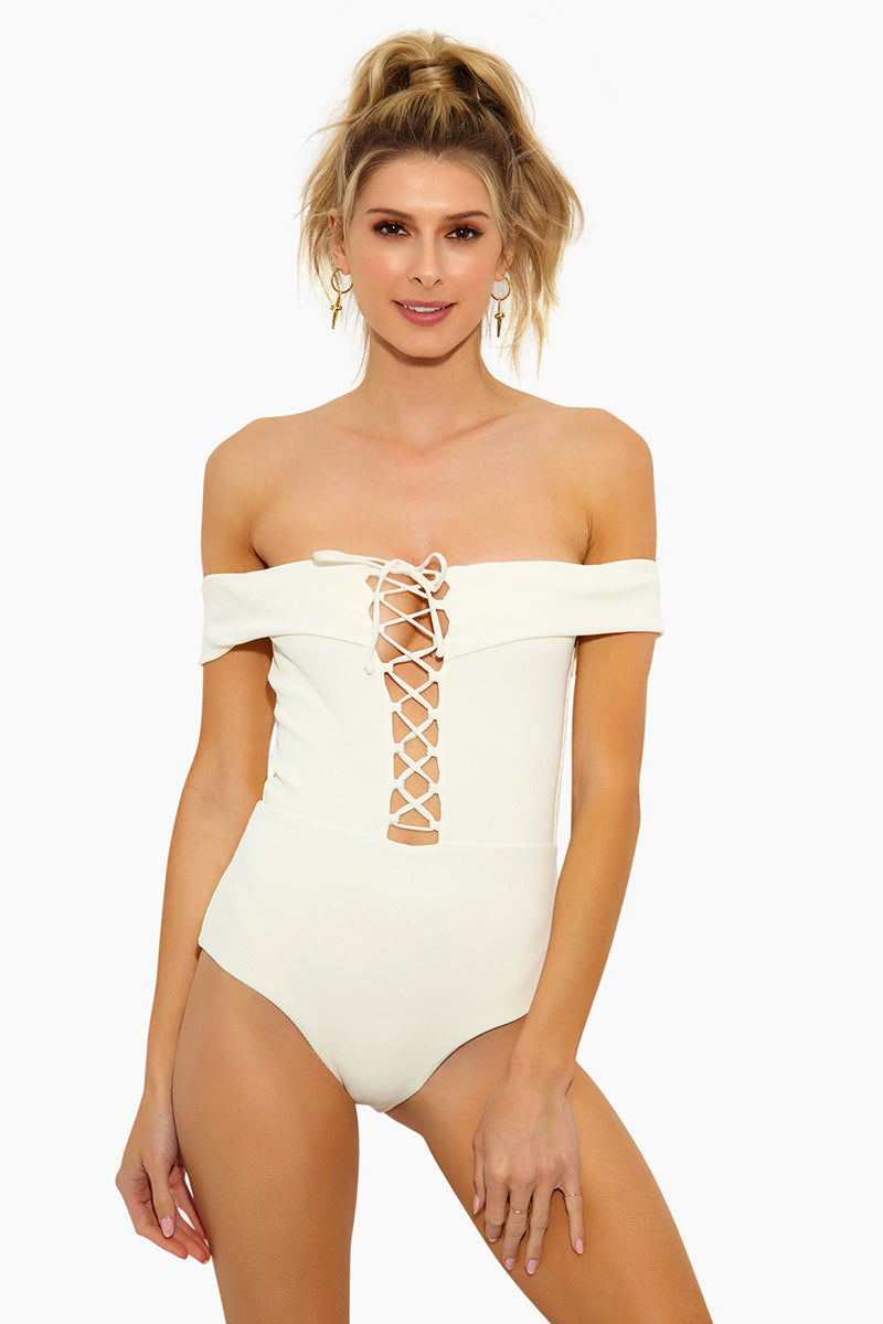 L SPACE Anja Off Shoulder One Piece Swimsuit - Cream One Piece | Cream | L Space Anja Off Shoulder One Piece Swimsuit - Cream Off-the-shoulder one piece Plunging neckline Adjustable lace-up front Classic coverage 80% poly, 20% spandex Made in USA Front View