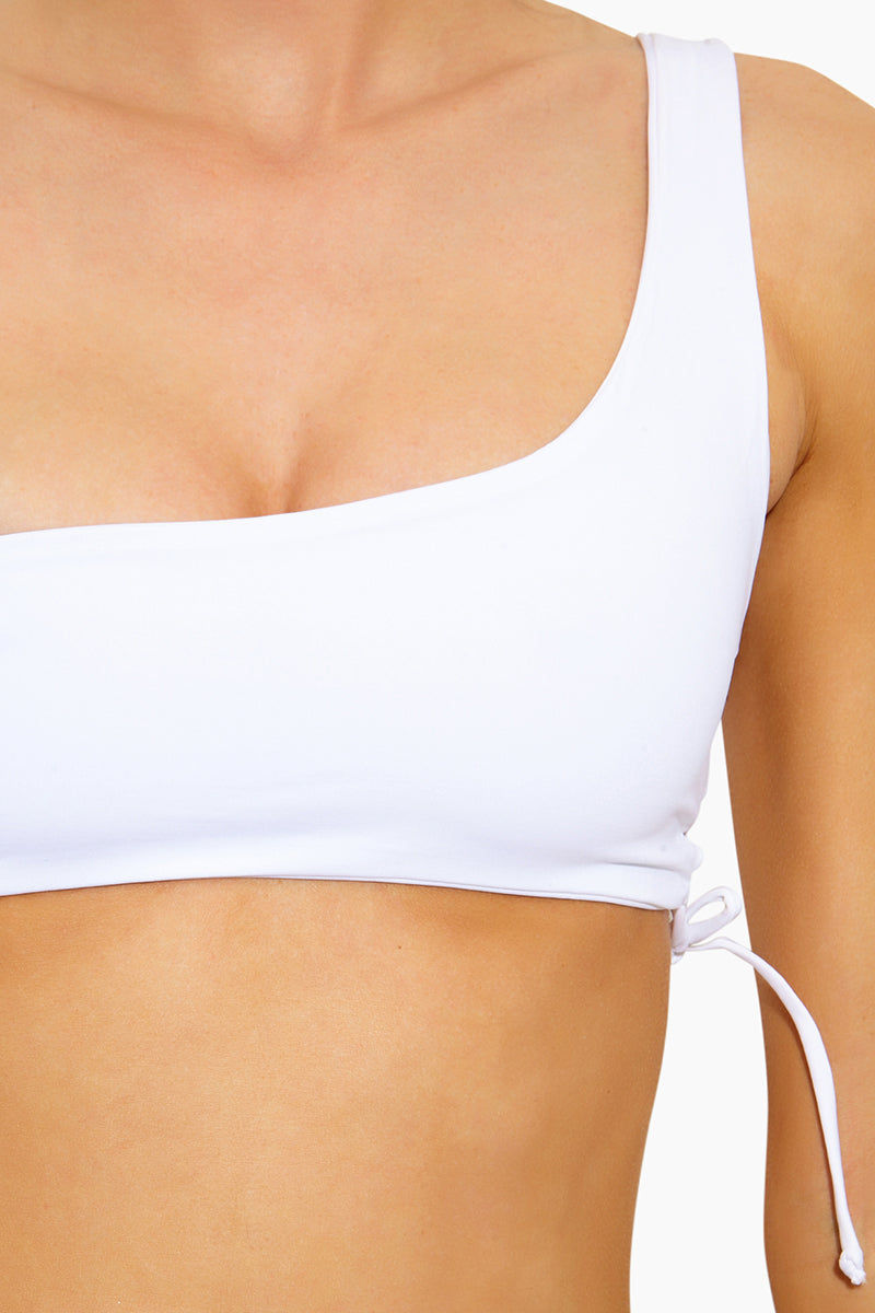 L SPACE Silver Lining One Shoulder Bikini Top - White Bikini Top | White| L Space Silver Lining One Shoulder Bikini Top - White  One shoulder Lace-up side Like all delicates, shape, color and fit are best preserved if hand washed in cold water. lay flat to dry Made in the USA 80% nylon, 20% spandex Close Up View