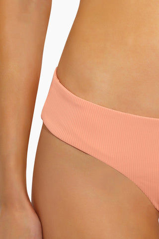 L SPACE Pixie Hipster Bikini Bottom - Tropical Peach Bikini Bottom | Tropical Peach| L Space Pixie Hipster Bikini Bottom - Tropical Peach Hipster Fit  Cheeky Coverage  80% nylon, 20% spandex.  Close Up View
