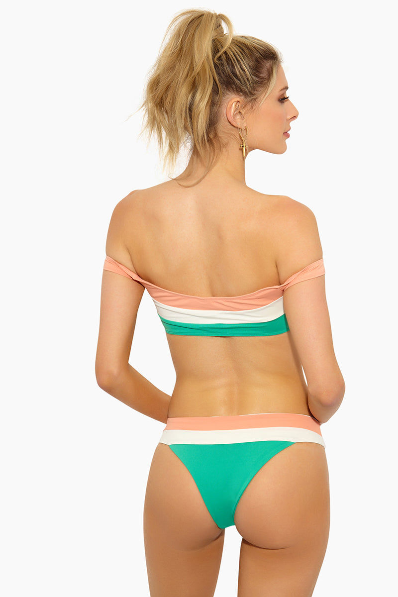 L SPACE Veronica Blocked Thick Band Bikini Bottom - Spearmint Color Block Bikini Bottom | Spearmint Color Block| L Space Veronica Blocked Thick Band Bikini Bottom - Spearmint Color Block Thick contrast band across waist that creates a fold-over look Color block panel design Seamless construction Available in bitsy and classic/moderate coverage 80% nylon, 20% spandex Made in the USA Like all delicates, shape, color and fit are best preserved if hand washed in cold water. Lay flat to dry. BackView