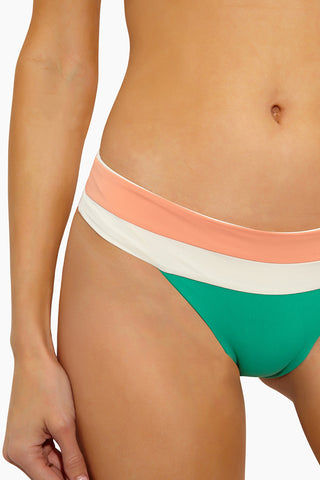 L SPACE Veronica Blocked Thick Band Bikini Bottom - Spearmint Color Block Bikini Bottom | Spearmint Color Block| L Space Veronica Blocked Thick Band Bikini Bottom - Spearmint Color Block Thick contrast band across waist that creates a fold-over look Color block panel design Seamless construction Available in bitsy and classic/moderate coverage 80% nylon, 20% spandex Made in the USA Like all delicates, shape, color and fit are best preserved if hand washed in cold water. Lay flat to dry. Close Up View