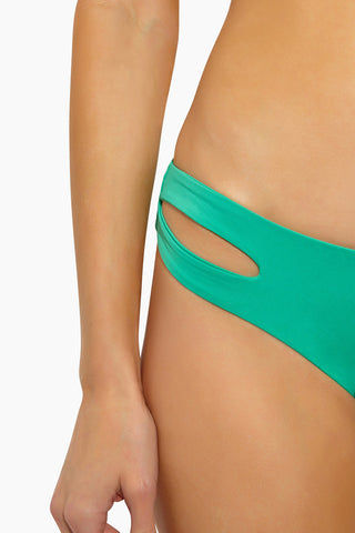 L SPACE Estella Side Cut Out Bikini Bottom - Spearmint Bikini Bottom | Spearmint | L Space Estella Side Cut Out Bikini Bottom - Spearmint  Smooth cut hipster bottom Low rise  Side cut out detail Seamless construction Moderate coverage 80% nylon, 20% spandex Made in the USA Close View