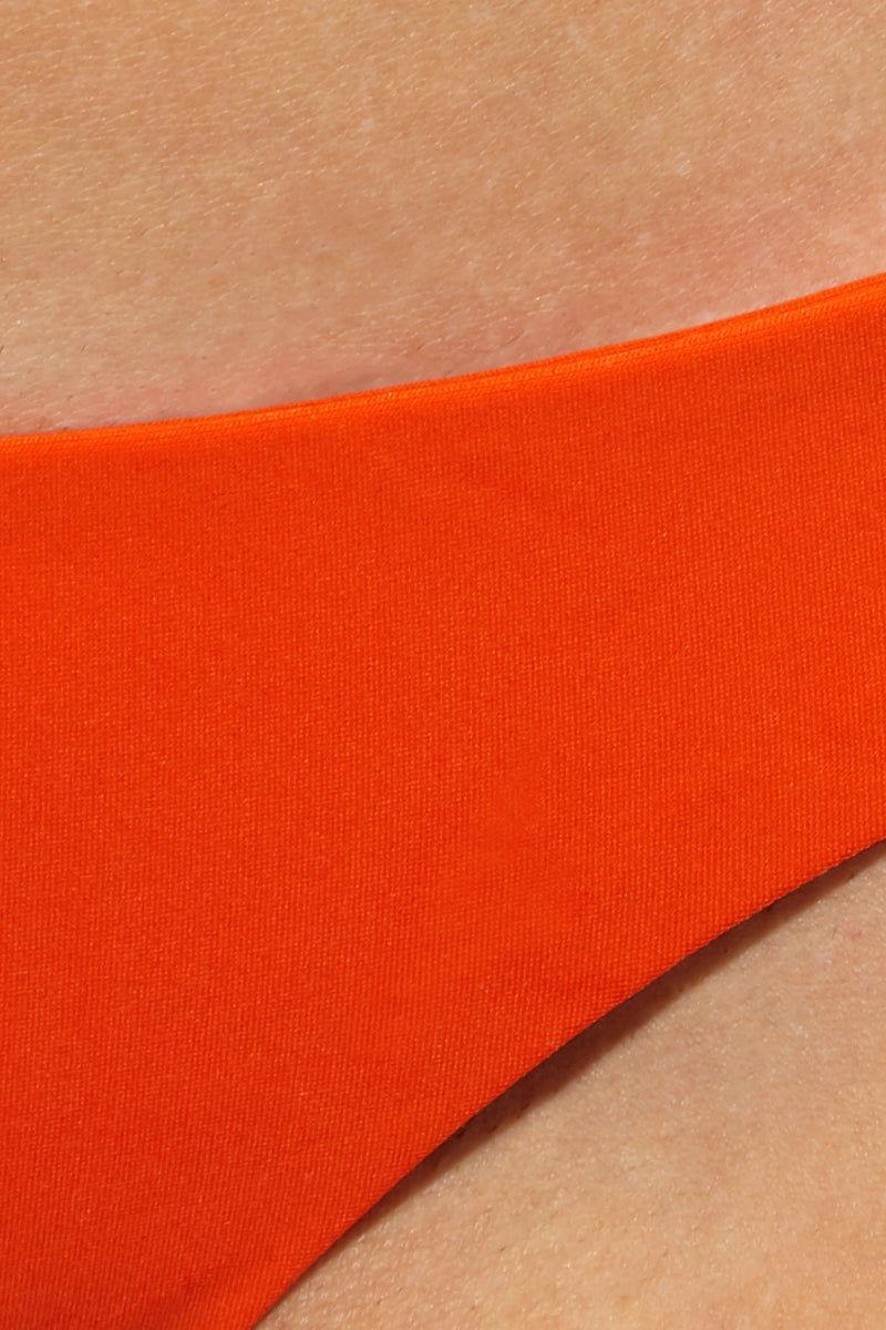 AILA BLUE Joel Side Tie Bikini Bottom - Pomelo Bikini Bottom | Pomelo|JJoel Side Tie Bikini Bottom - Pomelo. Features: Skimpy bikini bottom Side tie knot Vibrant orange color in Pomelo