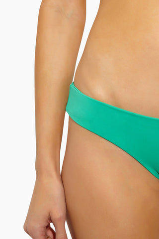 L SPACE Sandy Hipster Bikini Bottom - Spearmint Bikini Bottom | Spearmint| L Space Sandy Hipster Bikini Bottom - Spearmint Hipster fit bottom Seamless construction Moderate/classic coverage 80% nylon, 20% spandex Made in the USA Like all delicates, shape, color, and fit are best preserved if hand washed in cold water. Lay flat to dry. Close Up View