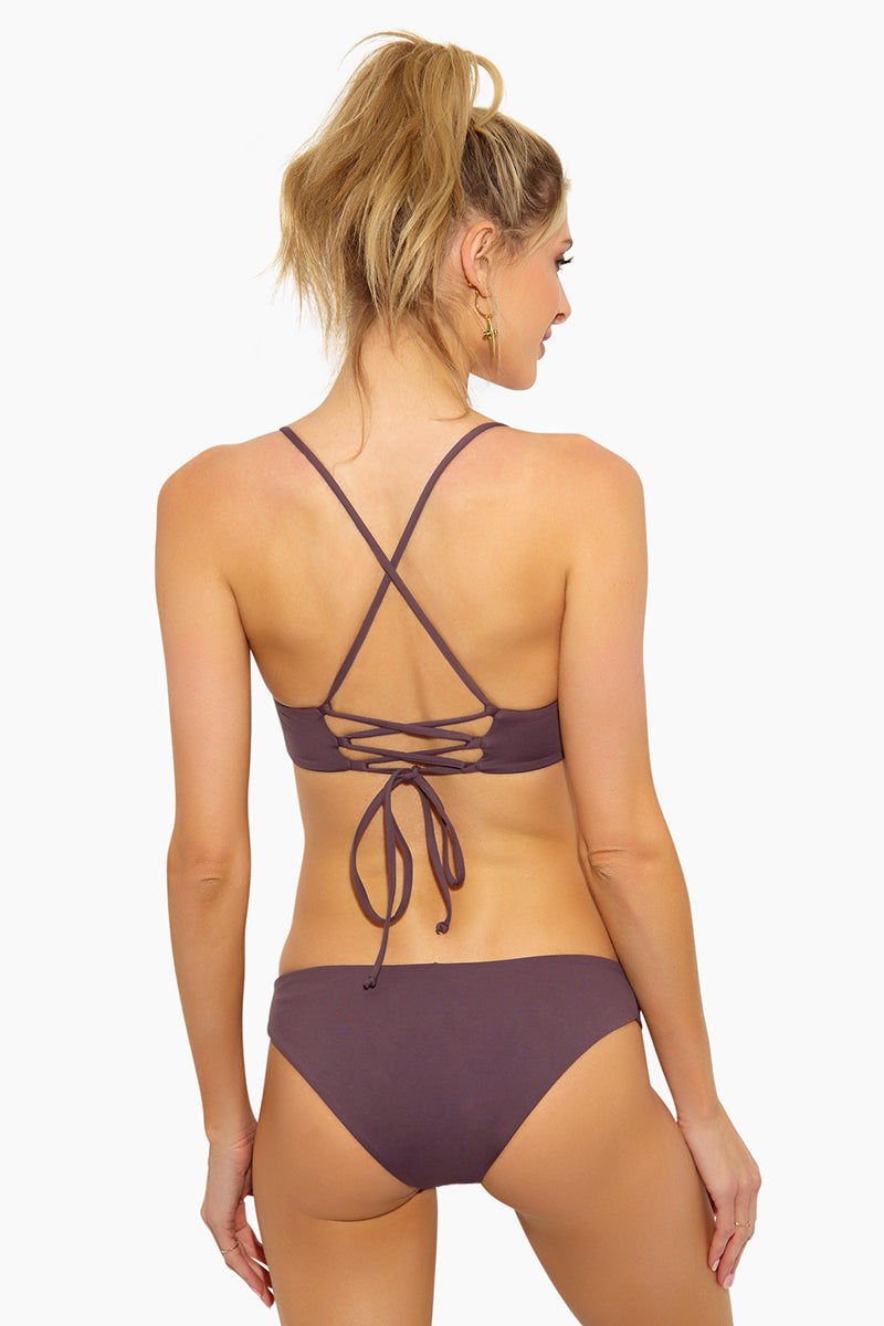 L SPACE Flynn Bralette Bikini Top - Pebble Bikini Top | Pebble| L Space Flynn Bralette Bikini Top - Pebble Bralette 3-strap center detail Laced X-back with adjustable ties Removable pads Fabric Content: 80% nylon, 20% spandex Like all delicates, shape, color and fit are best preserved if hand washed in cold water. Lay flat to dry Back View