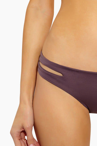 L SPACE Estella Side Cut Out Bikini Bottom - Pebble Bikini Bottom | Pebble| L Space Estella Side Cut Out Bikini Bottom - Pebble  Smooth cut hipster bottom Low rise  Side cut out detail Seamless construction Moderate coverage 80% nylon, 20% spandex Made in the USA Side Cut Out View