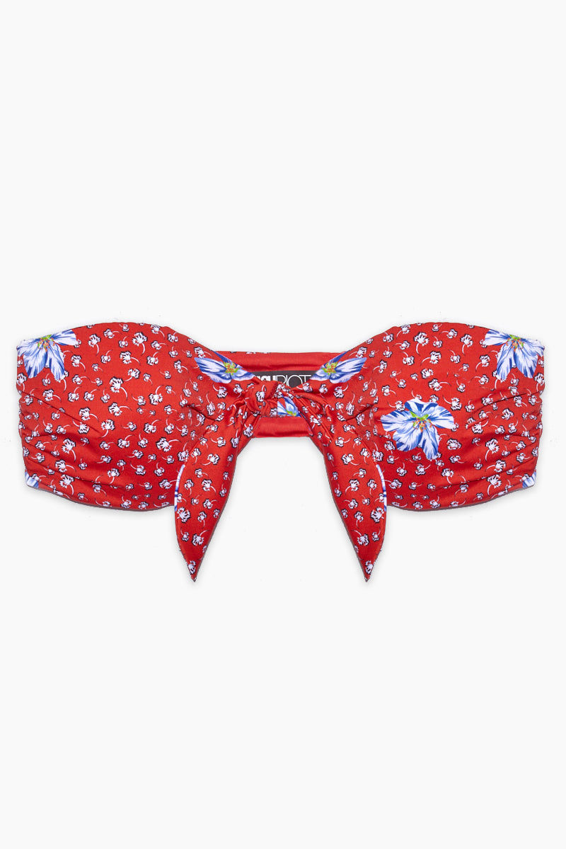 BEACH RIOT Sophie Front Knot Bandeau Bikini Top - Red Floral Bikini Top | Red Floral| Beach Riot Sophie Front Knot Bandeau Bikini Top - Red Floral Sweetheart Neckline Bandeau Front Knot Tie Rushed Side Detail Wide Back Band Polyester/Spandex blend Hand wash cold; lay flat to dry Made in the USA Flatlay View