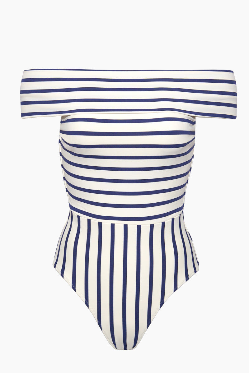 SOLID & STRIPED The Vera Off Shoulder One Piece Swimsuit - Navy Breton One Piece | Navy Breton| Solid & Striped The Vera Off Shoulder One Piece Swimsuit - Navy Breton. FEATURES:  Off-Shoulder One Piece Swimsuit Moderate coverage Made in Morocco Shell: 80% Polyester, 20% Elastane Lining: 8% Polyamide, 15% Elastane   CARE:   Hand wash in cold water, do not tumble dry. Flatlay  View
