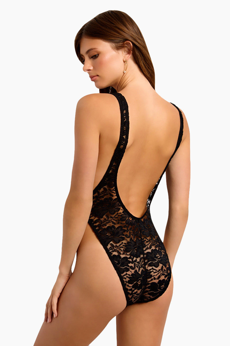 WE ARE HAH RebeccHAH Lace Bodysuit - Noir Bodysuit | Noir| Hot As Hell Rebecchah Lace Bodysuit - Noir All Over Lace Bodysuit Scoop Neckline Cut-in Armholes Side Boob Exposure Low Scoop Back High Cut Leg Back View