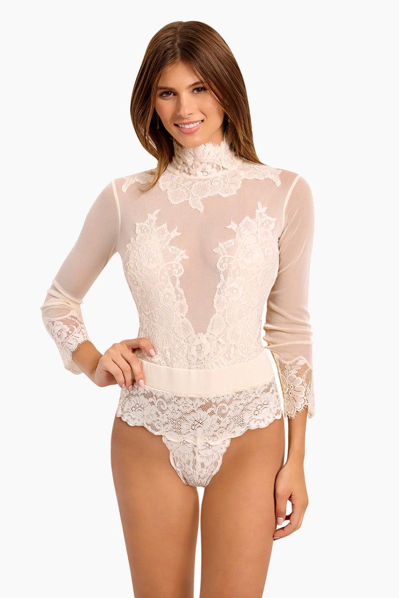WE ARE HAH Multi-Way Take HAH Bow Thong Bodysuit - La Crème Bodysuit   La Crème  Hot As Hell Reversible Take Hah Bow Bodysuit - La Crème Can Be Worn Front or Back Long Sleeves Turtleneck with Button Closure  Satin Sash Cinches  Tie Bow Front Or Back  Cheeky Lace Brief  Fully Lined  Front View