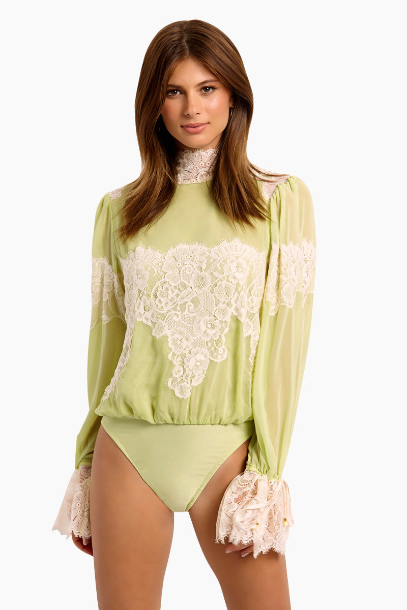 WE ARE HAH Queen 4 A Day Bodysuit - Sage My Name Bodysuit | Sage My Name| Hot As Hell Queen 4 A Day Bodysuit - Sage My Name  Lace & Chiffon Bodysuit  Lace Turtle Neck Oversized Sleeves  Ties At The Wrist  Comfortable Knit Brief Front View
