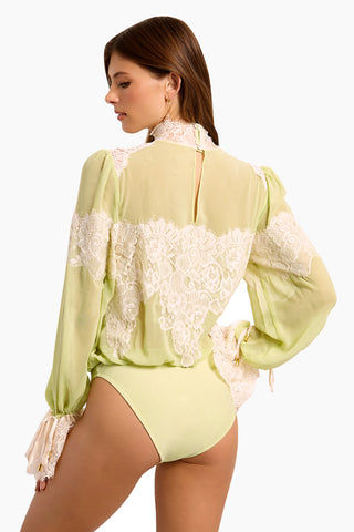 WE ARE HAH Queen 4 A Day Bodysuit - Sage My Name Bodysuit | Sage My Name| Hot As Hell Queen 4 A Day Bodysuit - Sage My Name  Lace & Chiffon Bodysuit  Lace Turtle Neck Oversized Sleeves  Ties At The Wrist  Comfortable Knit Brief Back View
