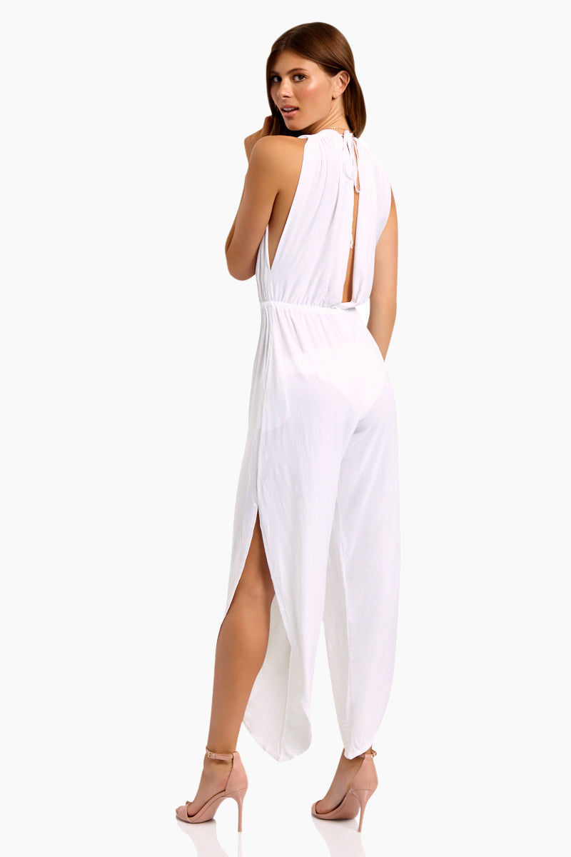 WE ARE HAH Michele HAH Belle Capri Jumpsuit - Blanc Jumpsuit | Blanc| Hot As Hell Michele Hah Bell Jumpsuit - Blanc Features:  Deep V Front & Back  Back Tie Closure  Essential Deep Pockets  Elastic Waist Loose Fitting Pant Legs Side Slits  NAUGHTY KNIT: 90% Polyester, 10% Spandex   Care Machine wash cold, hang to dry Back View