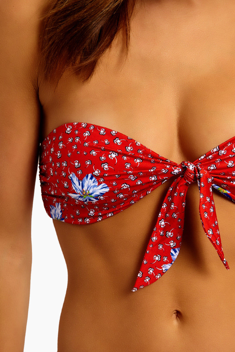 BEACH RIOT Sophie Front Knot Bandeau Bikini Top - Red Floral Bikini Top | Red Floral| Beach Riot Sophie Front Knot Bandeau Bikini Top - Red Floral Sweetheart Neckline Bandeau Front Knot Tie Rushed Side Detail Wide Back Band Polyester/Spandex blend Hand wash cold; lay flat to dry Made in the USA Close Up View