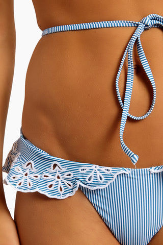 BEACH RIOT Chloe Ruffle Cheeky Bikini Bottom - Blue & White Stripe Bikini Bottom | Blue & White Stripe| Beach Riot Chloe Ruffle Cheeky Bikini Bottom - Blue & White Stripe  Ruffle detailed bikini bottom Eyelet detail on ruffle Blue & white stripe print Very cheeky minimal coverage High leg cut style Close Up View