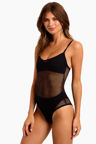 L SPACE Mesh Madness One Piece Swimsuit - Black One Piece | Black|L Space Mesh Madness One Piece Swimsuit - Features:  Mesh overlay one piece Attaches to undersuit at side bust and hip points Adjustable straps Pull-on style Bitsy coverage Side View